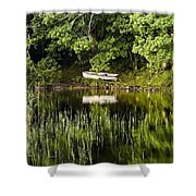 Rowboat Moored On The Bank Of A Lake Shower Curtain