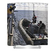 Sailors Lift A Rigid-hull Inflatable Shower Curtain