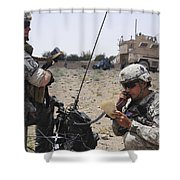Soldiers Setting Up A Satellite Shower Curtain