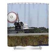 Space Shuttle Atlantis Unfurls Its Drag Shower Curtain