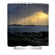 storm light - A morning light iluminates lighthouse through clouds in an amazing landscape Shower Curtain