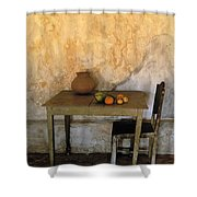 Table And Chairs Infront Of Weathered Shower Curtain