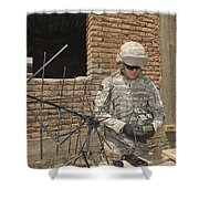 U.s. Army Soldier Configures Shower Curtain