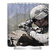 U.s. Army Soldier Monitors An Afghan Shower Curtain