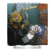 U.s. Navy Diver Uses A Grinder To File Shower Curtain by Stocktrek Images