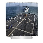 U.s. Navy Sailors Prepare To Attach Shower Curtain