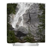 Water Cascading Down The Rock And Shower Curtain