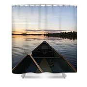 A Boat And Paddle On A Tranquil Lake Shower Curtain