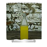 A Bottle Of Limoncello Sits On A Picnic Shower Curtain