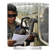 A Honduran Crew Chief Consults Shower Curtain