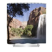 A Large Waterfall Hydrates A Narrow Shower Curtain