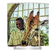 A Rothchild's Giraffe Munching Horse Pellets Through An Open Window Shower Curtain
