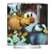 A Rudolph The Red Nosed Reindeer Ornament With A Penguin Shower Curtain