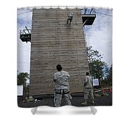 A U.s. Soldier Rappels Down A 40-foot Shower Curtain