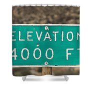 A Weathered Elevation Sign On Highway Shower Curtain