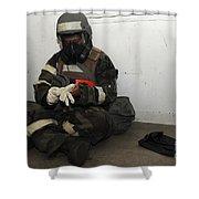 Airman Dons His Chemical Warfare Shower Curtain