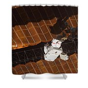 An Astronaut Anchored To A Foot Shower Curtain