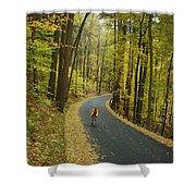 Biker On Road Amidst Fall Foliage Shower Curtain