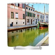 boat in a canal of the colorful italian village of Comacchio in  Shower Curtain