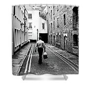 Man Walking With Shopping Bag Down Narrow English Street Shower Curtain