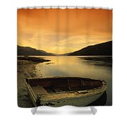 Old Rowboat At Waters Edge With Sunset Shower Curtain by Don Hammond