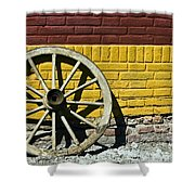 Old Wooden Wheel Against A Wall Shower Curtain
