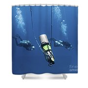 Technical Divers Ascend Near A Nitrox Shower Curtain by Karen Doody