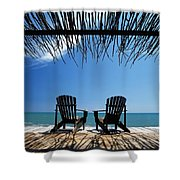 Two Chairs On Deck By Ocean Shaded By Shower Curtain