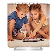 Two Happy Children Playing On The Tablet Shower Curtain