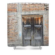 Weathered Wood Door In An Adobe Brick Wall Shower Curtain