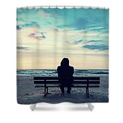 Man In Hood Sitting On A Lonely Bench On The Beach Shower Curtain