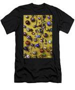 Marbles On Yellow Wooden Table Men's T-Shirt (Athletic Fit)