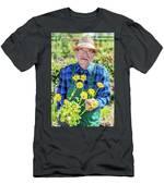 Senior Gardener Showing A Potted Flower. Men's T-Shirt (Athletic Fit)