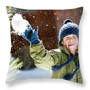 A Boy Throws A Snowball While Playing Throw Pillow