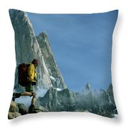 A Man Backpacks In Front Of Fitz Roy Throw Pillow