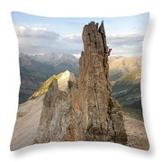 A Man Tops Out A Spire On Treasure Throw Pillow