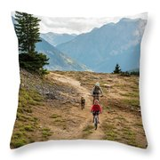 A Mother And Daughter Mountain Biking Throw Pillow