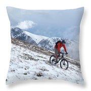 A Mountain Biker Rides Through The Snow Throw Pillow