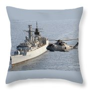 A Royal Navy Merlin Helicopter Passes Over Hms Cumberland Throw Pillow