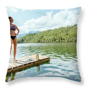 A Woman Is Standing On A Jetty Throw Pillow