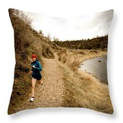 A Woman Jogging On A Dirt Trail Throw Pillow