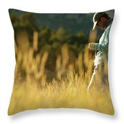 A Young Man Fly-fishing At Sunset Throw Pillow