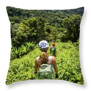 A Young Woman Hikes Through The Jungles Throw Pillow