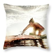 A Young Woman Paddling Hard Throw Pillow