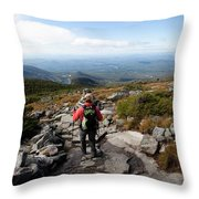 An Athletic Female Hiker Hikes Throw Pillow