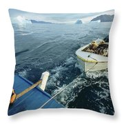 An Inuit Hunter Ferries His Sled Dogs Throw Pillow