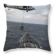 An Mh-60s Sea Hawk Helicopter Delivers Throw Pillow