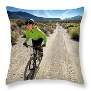 Attractive Woman Riding Her Mountain Throw Pillow