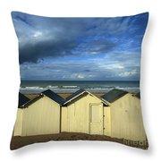 Beach Huts Under A Stormy Sky In Normandy. France. Europe Throw Pillow by Bernard Jaubert