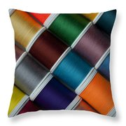 Bright Colored Spools Of Thread Throw Pillow